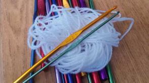 ball of yarn and crochet needles