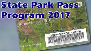 Image of 2017 state park pass card, featuring canoers in Versailles State Park.