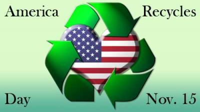 Recycling symbol hugging a heart with the American flag on it.