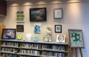 Display of several paintings including abstracts, still lifes and landscapes