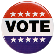 """Image of a campaign button reading """"Vote."""""""
