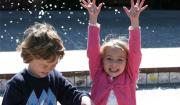 "Photo of kids enjoying flower blossom ""snow"" by John-Morgan via flickr"
