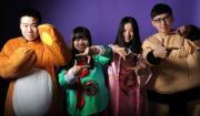 Costumed teens making video poses
