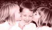Siblings kissing