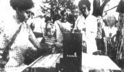 Newspaper photo of weaving demonstration