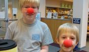 Two DeMotte patrons with red clown noses - part of put your nose in a book.
