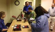 Photo of Logan Judy signing books after the program at the library.