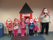 kids with Clifford the Big Red Dog masks
