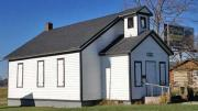 Exterior shot of modern preserved one-room school house.