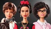 Three posed dolls from Barbie® representing famous women in history.