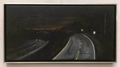 Painting of I-65 going through windmills at night.
