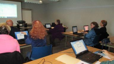 Photo of a class using the mobile lab at the DeMotte Library.