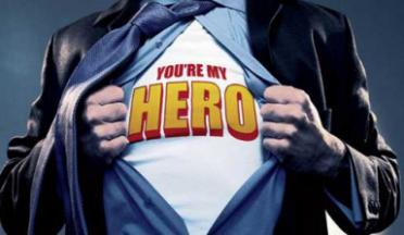 "man parting dress shirt to reveal t-shirt that reads ""you're my hero"""