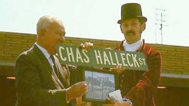 Charlie Halleck is presented with a street sign bearing his name.