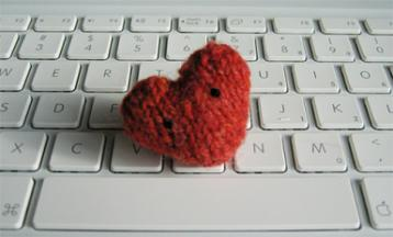 photo of a knitted heart on a keyboard