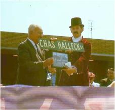 Charlie Halleck is presented with a street sign bearing his name. - Full image.