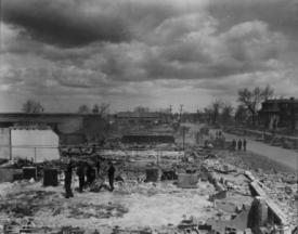 Photo of the devastion, a full city block of buildings reduced to rubble.